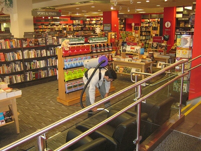 Vacuuming Library With Backpack Vacuum
